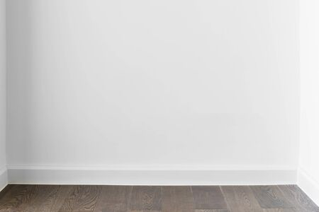 Abstract background from blank white concrete wall at home or office with wooden floor. Picture for add text message. Backdrop for design art work. Zdjęcie Seryjne