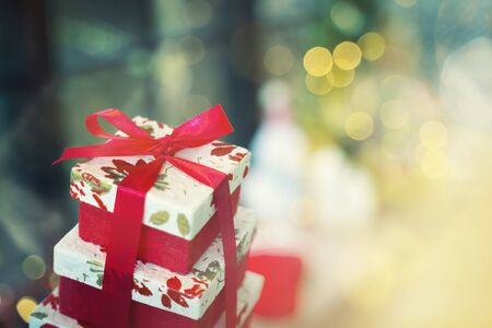 Gift box with bokeh blurred lighting background. Can use as Merry Christmas party, Happy New Year or Happy birthday background. 写真素材