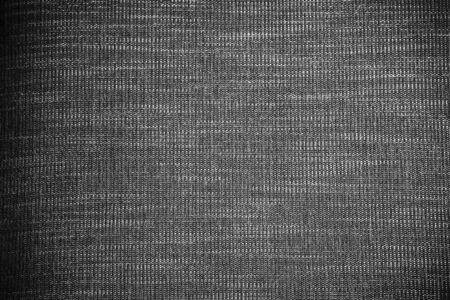 Abstract background from black fabric texture. Picture for add text message. Backdrop for design art work. Banco de Imagens