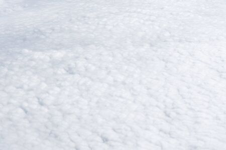 White clouds scape top view. Pure natural air weather background. Freedom and travel concept. 写真素材