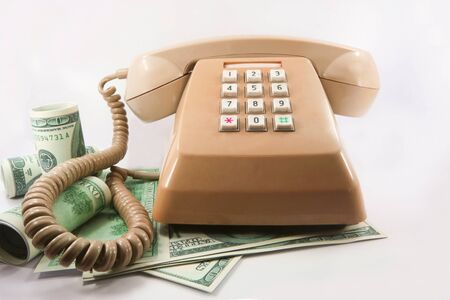 Old phone with the money. Stock Photo - 9679070