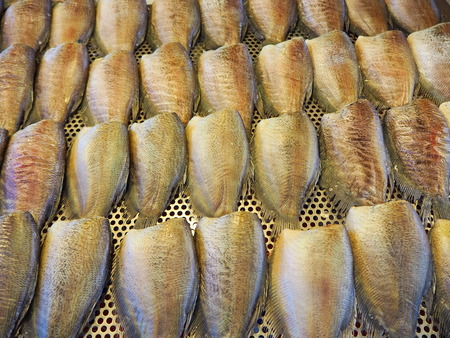 One sunny fish in a bamboo tray Stock Photo