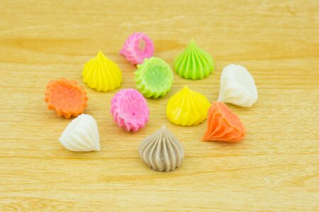 Aalaw candy, colorful Thai dessert on wood background