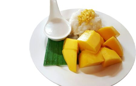 Mango sticky rice on a white plate,selective focus