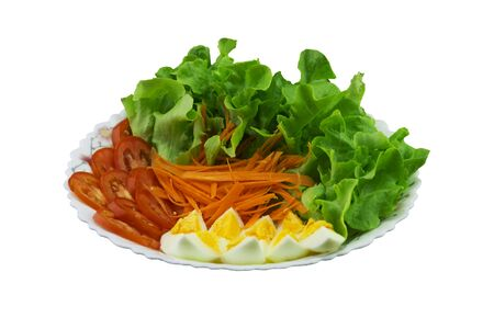 Lettuce, carrots, tomatoes and boiled eggs on the plate