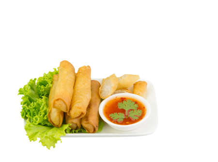 Fried spring rolls with lettuce and dipping sauce on a white plate. Stok Fotoğraf