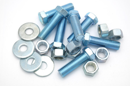metal fastener: new nuts and bolts on white background