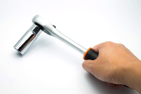 ratchet: hand holding ratchet wrench on the white background