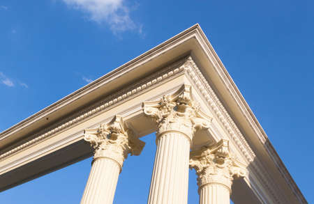 seminal: roman poles with blue sky, exterior building