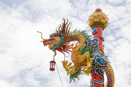 Dragon sculpture with blue sky, Dragon in Chinese temple Beautiful Dragon, Dragon wrapped around a pole
