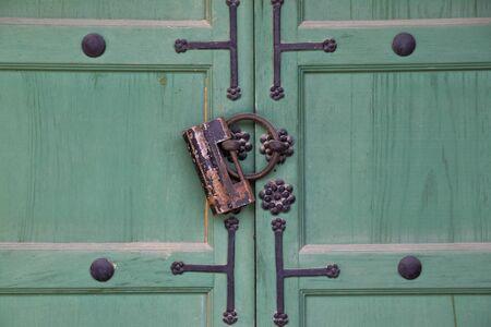 Antique lock on green gates Stock Photo