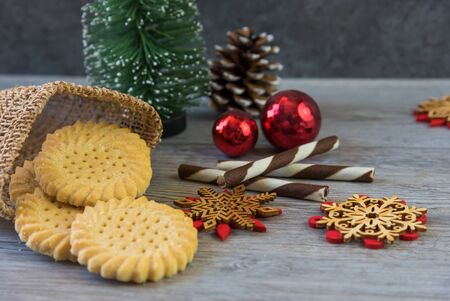 Tasty homemade Christmas cookies on wooden table, gingerbread cookies on dark wood background with copy space for text. holiday, celebration and cooking concept. closeup view