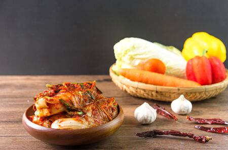 Traditional Korean Kimchi in a bowl on wooden background, top view, Korean food ,Korean food traditional cuisine. Fermented food. Vegetarian food good for health, Vegan for weight control diet