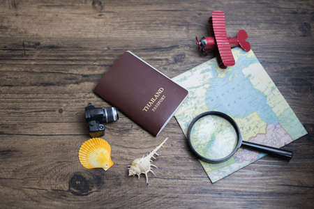 time to travel in vocation concept, wanderlust holiday background flat lay, space for text. camera passport map camera on wooden table. planning summer holiday. Travel and tourism concept. Stockfoto