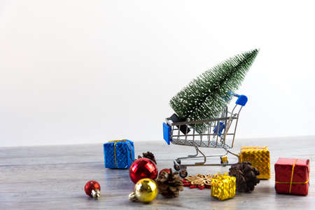 shopping trolley with gifts in Chirstmas shopping. Online shopping concept - trolley cart full of presents for sales in chirstmas, new year holiday in last year.