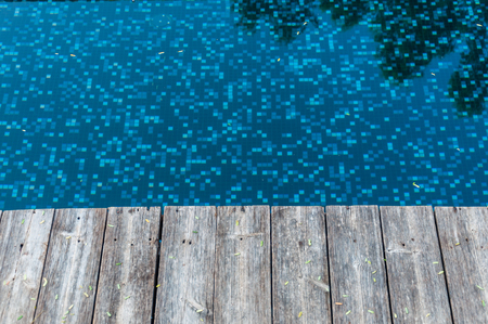 wood floor beside pool photo