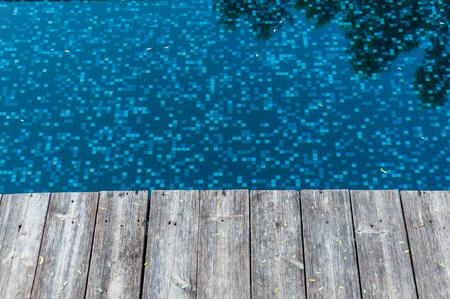 wood floor beside pool photo