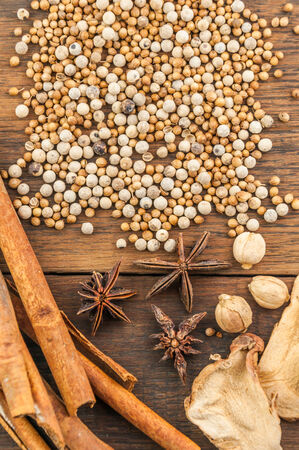 spices on wood background photo