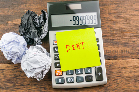 delinquent: debt on notepad & calculator : concept for debt Stock Photo