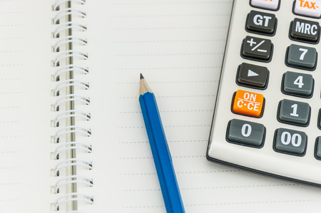 pencil   calculator on notebook, concept for office work Stock Photo - 28002452