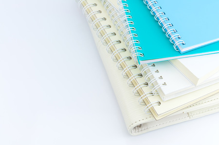 stack of organizer and notebooks on white background Banco de Imagens