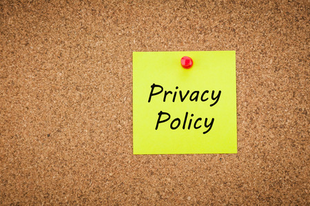 privacy policy concept, sticky pinned to cork board with room for text. photo