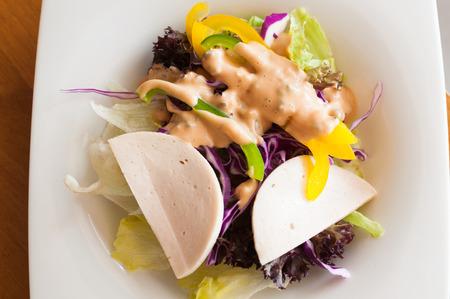 salad plate: Salad plate on wood table