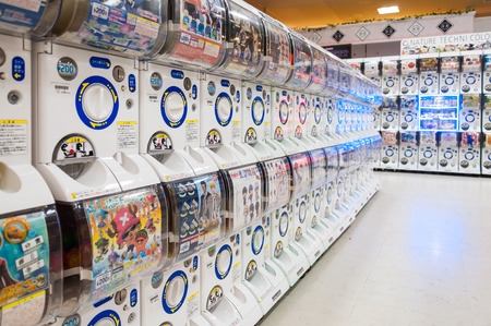 KYOTO, JAPAN - OCTOBER 24, 2015: Rows of Gashapon machines in department store, popular vending machine dispensed capsule toys showing manga character figure, Kyoto, Japan.