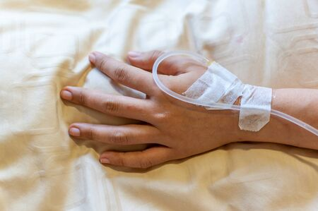 Woman hand with IV line. Stock Photo