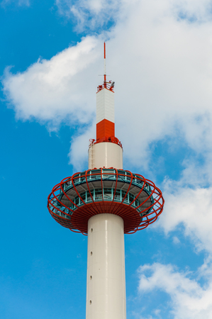 KYOTO, JAPAN - OCTOBER 27, 2015: View of Kyoto Tower with blue sky, The tower was completed in 1964, the same year as the opening of the shinkansen and the Tokyo Olympics.
