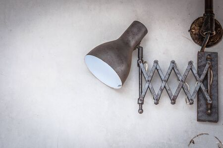 Vintage lamp on the wall.