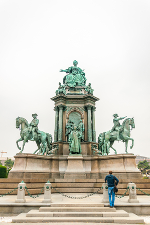 VIENNA, AUSTRIA - OCTOBER 07, 2013: A man standing at Maria Theresia Monument, in Vienna, Austria. The monument was built by Kaspar von Zumbusch in the year 1888