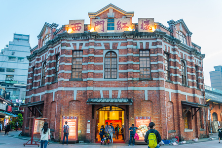 TAIPEI, TAIWAN - APRIL 29, 2016: People at Red House Theater, Taipei, Taiwan. Built in 1908, this landmark 8-sided structure features exhibits, a teahouse, markets & theaters.