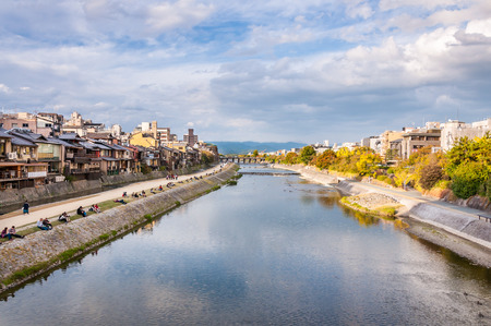 KYOTO, JAPAN - OCTOBER 27, 2015: View of Kamo River. The Kamo River is located in Kyoto Prefecture, Japan. The riverbanks are popular walking spots for residents and tourists.