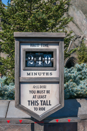 OSAKA, JAPAN - OCTOBER 26, 2015: Wait time sign at The Wizarding World of Harry Potter in Universal Studios Japan. Located in Osaka, is one of four Universal Studios theme parks.