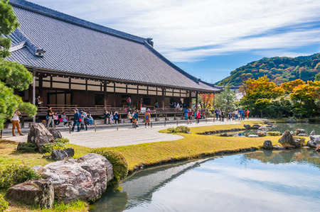 KYOTO, JAPAN - OCTOBER 27, 2015: People at Tenryujis Garden, Arashiyama, Kyoto. Tenryuji was built in 1339 by the ruling shogun Ashikaga Takauji. Redakční