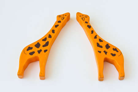 a couple of wooden giraffes