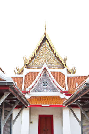 thai beautiful temple with decorative brown mosaic roof and red door