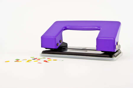 paper puncher: purple paper puncher or paper driller isolated on white