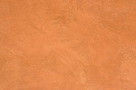 background: brown clay wall and floor