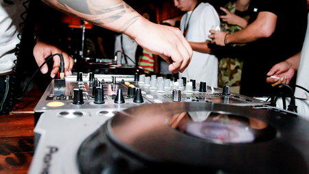 sound mixer: party in the pub with sound mixer and dj was playing the music Stock Photo