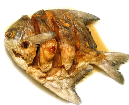fish sauce: one of fried fish with fish sauce in restaurant