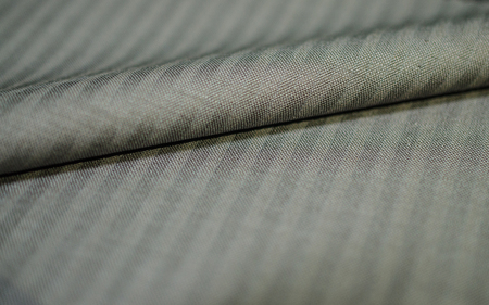 fabric roll: close up roll gold fabric of suit, photoshoot by depth of field for object