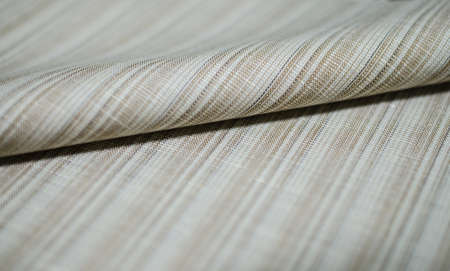 field stripped: close up roll bright brown fabric of suit, photo shoot by depth of field for object