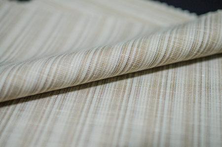 close up roll bright brown fabric of suit, photo shoot by depth of field for object