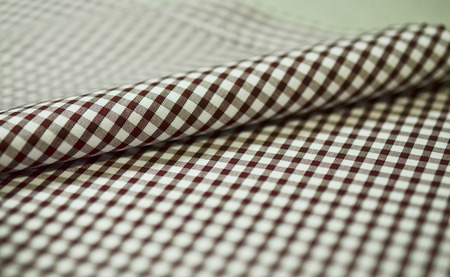 fabric roll: close up roll brown scott pattern fabric of shirt, photo shoot by depth of field for object