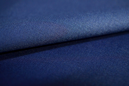 azul marino: close up roll texture navy blue fabric of suit, photo shoot by depth of field for object