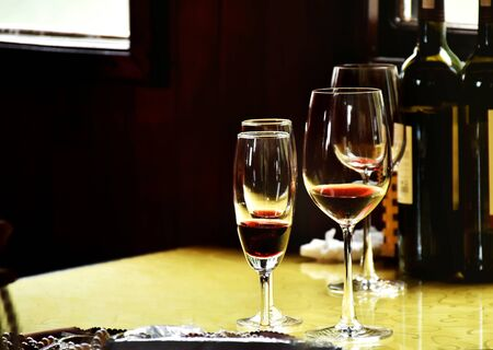 Red wine in clear wine glass ready to eat or serve for customer. Luxury red wine for rich people place on wooden table decoration in classic and luxury style. Stock fotó
