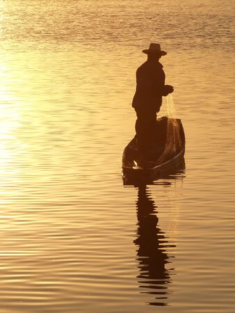'catch the moment': Fisherman in sunlight