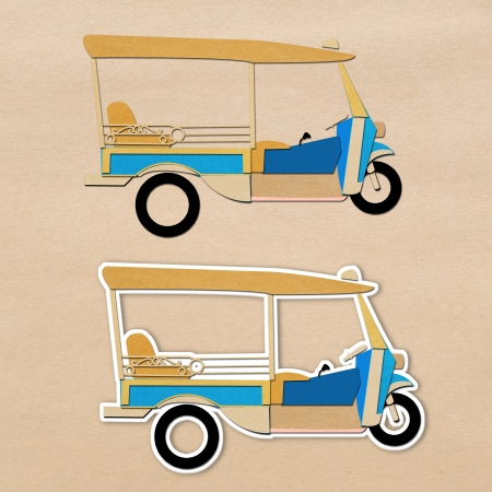 Paper craft of Tuk tuk Thai style taxi  photo
